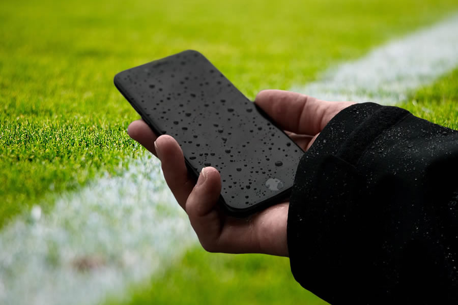 Wet Cellphone on a Soccer Field Image